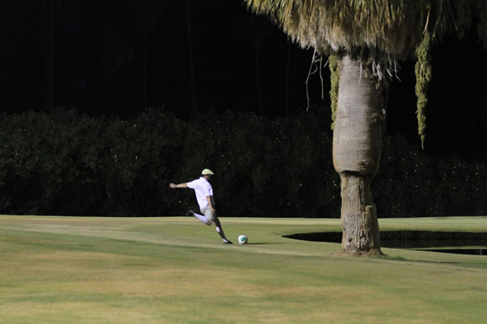 A person plays footgolf on the course at Indio Golf Course
